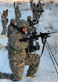 Soldiers assigned to 6th Engineer Battalion (Combat) (Airborne) prepare to fire at a range in the kneeling supported position using ski poles during Arctic Light Individual Training (ALIT) on Bulldog Trail, Thursday, Dec. 6, 2012, in sub-zero conditions. ALIT is the United States Army Alaska's Cold Weather Indoctrination (CWI) program; gives all Soldiers, regardless of their job, the foundation to successfully work, train, and go to war in some of the harshest environments in the world.