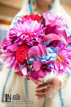 Exotic floral bouquet with touches of red and purple flowers.