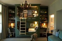 Love the details. Built in bunk beds with a ladder and desks with bookshelves! The dark color with all the built in lights area  fabulous contrast!