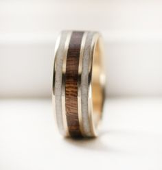Image of 10k Gold ring with Desert Ironwood and Antler inlays