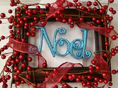 Wreaths I would change the noel color to green and probably put our last name instead :)