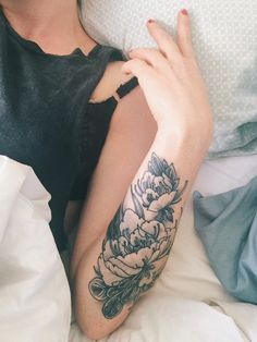 floral black line Arm Tattoo.