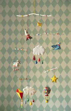 paper mache mobile with flying objects for nursery room from marysmerryland.blogspot.gr
