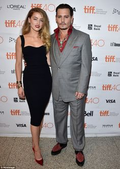 Honing his style: Johnny Depp was suited up fine as he attended the Toronto International Film Festival premiere of his crime drama Black Mass with wife Amber Heard on Monday