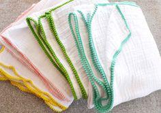 """Baby Blanket- Cotton Muslin / Gauze Baby Blanket with """"Mustard Yellow"""" Pom Pom Trim. $27.00, via Etsy."""