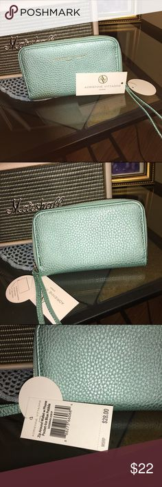 ‼️Sale‼️Vittadini wallet w/phone pocket Brand new! Tags on! Ice Blue Pebble wallet with phone pocket. It also has 4 card holders  and one open window. Adrienne Vittadini Bags Wallets