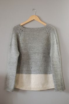I love the subtle color block.  Adds a nice touch of detail to a simple pullover sweater.