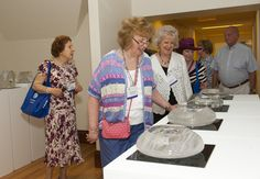 Members of the Class of 1963 explore the Art Department during Alumni Weekend.