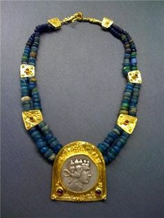 1800 year old Roman glass beads and Greek coin depicting Dionysus set in modern 22k gold frame with 22k gold stations, by Michele Delville