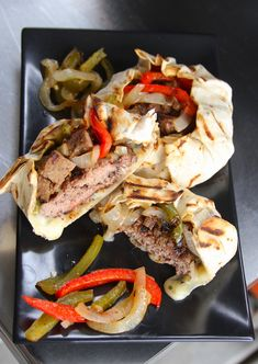 Fajitas just got a whole lot better! With a burger in the middle of a tortilla surrounded by melted cheese and fajita veggies, this recipe is a keeper!!