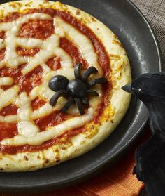 pizza with a black olive spider