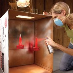 Use an old cardboard box to make a 'spray booth' to prevent paint overspray when painting inside with spray paint