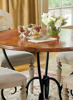 Enhance your eat-in kitchen space with the gorgeous Milano Copper Top Dining Table that boasts a one-of-a-kind hand-forged copper surface.