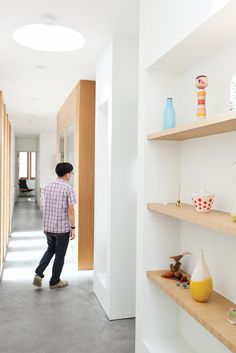 White paint / light wood combo... Recessed shelving with pops of color