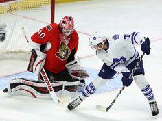 The Maple Leafs' David Clarkson attempts a backhand shot at Senators goaltender Robin Lehner