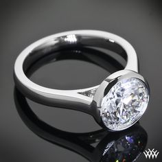 """Hearts and Arrows, This """"Cameron"""" Solitaire Engagement Ring is set in platinum and holds a gleaming 2.10ct A CUT ABOVE® Hearts and Arrows Diamond."""