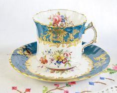 Hammersley cup and saucer, saucer signed F howard, richly gilded