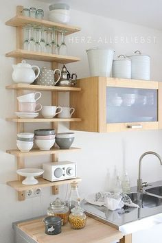 This is very much my style--open, natural wood shelving, and all the dishes are cute.  And there are polka dots!