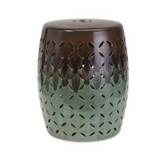 "Featuring a cutout design and 2-tone brown and sea green finish, this eye-catching ceramic garden stool is perfect as an eclectic end table in your den or extra seating on the patio.   Product: Garden stoolConstruction Material: CeramicColor: Brown and sea greenDimensions: 20"" H x 17"" Diameter"