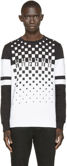 Long sleeve sweatshirt in black and white. Ribbed crew neck collar, cuffs and hem. Gradient check pattern at front in black and white with logo. Panelled stripes at sleeves. Tonal stitching.