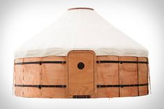 Trakke Jero Tent - inspired by the yurt, it has been refined to minimize weight & increase packability, it is built to pack small, so it can move it in a car or even by bicycle trailer! Jero is made from marine plywood, a lightweight material with inherent strength & ability to withstand harsh environments, & features a waterproof canvas cover.