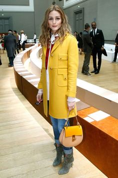 30 Times Olivia Palermo Was The Ultimate Street Style MVP #refinery29  http://www.refinery29.com/olivia-palermo-style-pictures#slide-23  A yellow overcoat makes peacocking at Fashion Week easy....