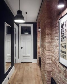 Masculine entryway with exposed brick walls and dark hues. Loft Interior, Brick Interior, Home Interior Design, Interior Decorating, Flur Design, Hall Design, Design Design, Exposed Brick Walls, Hallway Designs