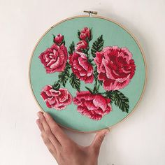 Embroidery Roses Five luscious pink/red roses and a couple little rosebuds hand embroidered on minty green fabric, glued into a wooden hoop and ready to hang on the wall. Rose Embroidery, Learn Embroidery, Cross Stitch Embroidery, Hand Embroidery Tutorial, Hand Embroidery Patterns, Red And Pink Roses, Satin Stitch, Embroidery Techniques, Etsy