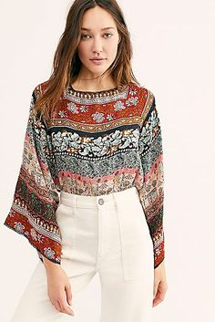 Presented by Free People. Boldly patterned bodysuit featured in a blousy silhouette with long flared sleeves and an open tied back. A look for every season. Boho Fashion Over 40, Fashion For Women Over 40, 50 Fashion, Plus Size Fashion, Fashion Outfits, Womens Fashion, Modest Wear, Bodysuit Fashion, Beautiful Blouses