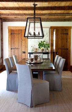 Beautiful Dining room. Love the blue Slipcovers. Designed by Orrick and Company