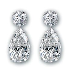 18K white gold earrings set with exquisitely matched pear shape diamonds totaling 24.50 carats topped with 2 round brilliant diamonds totaling 6.28 carats