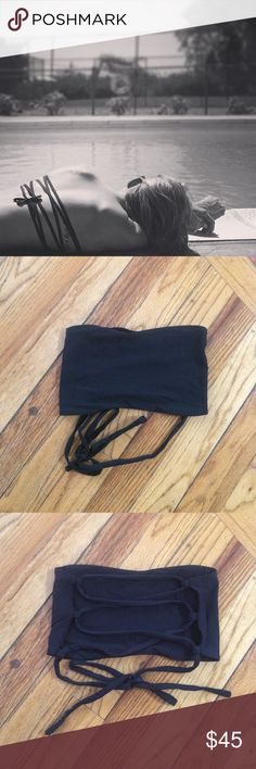 L Space byrdie top size small black bikini top Gorgeous back, worn minimally. Can be tied multiple ways for different looks! No trade. Tag has been removed but this is 100% authentic. Strapless top. l*space Swim Bikinis