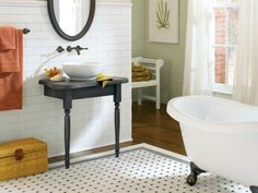 Wall mount faucet and vessel sink on white subway tile with concealed plumbing.