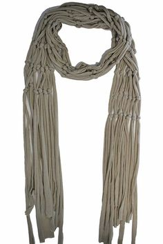 This edgy & glamorous rocker style scarf is made from lightweight & soft jersey material. The body of the scarf is in a weaved pattern & is finished on each end with long shredded fringe. Sure to lend