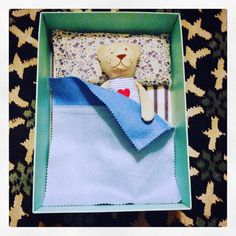 """""""Made a ticking-striped mattress, felt coverlet and Liberty print pillow for teddy tonight. As you can see he appreciates his shoe box bed so much he's…"""" - Thanks to @fullerton_fash"""