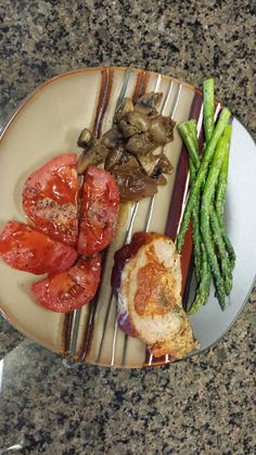 Spinach Stuffed Meatloaf, Mushrooms with onions that were cooked on the grill and Asparagus and Tomato