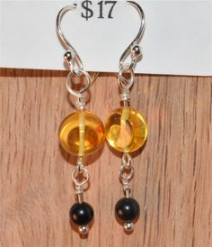 Light Amber & Jet Earrings, on Silver-plated Wire & Sterling Silver Fish Hooks - $17. at: www.ETSY.com/shop/HarpersCauldron.  Amber is known as a protective stone, which will cleanse and heal the aura. It is associated with the Sacral chakra, and helps to balance and cleanse the chakras. Jet is a protective stone, guarding against illness and violence. It helps with stability and balance.