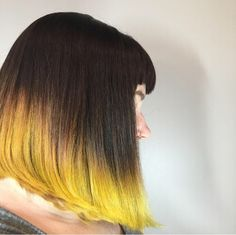 Comic book hair! Deep brunette base melted into bright yellow ends on a cute blunt bob!
