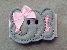 Felt Elephant on a 2 inch snap clip that has been covered in a Pink Grosgrain ribbon to keep it from slipping out! Way better then Alligator clips!!  Ive got 5 girls and swear by snap clips!!  Carlykins Boutique Baby Girl Hair Accessories by CarlykinsBoutique, $4.25