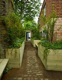 Courtyard raised beds and flagstones/cobblestones.  Image courtesy of House and Garden UK.