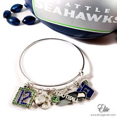 Are you ready for football season? We Are!  Our NEW! 'Seahawks Charm Bangle' Is Now Available! Tag a Seahawks fan who needs this bracelet. Go Hawks!!! | Shop: www.DivulgeVein.com