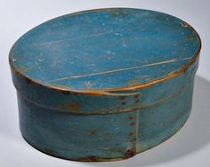 "Skinner's - The Personal Collection of Lewis Scranton, Auction 2897M. May 21, 2016. Lot: 188.  Estimate: $400-600.  Realized: $900.   Description:  Large Blue-painted Pantry Box, America, 19th century, oval, with fingered lid, initialed ""IS"" on lid, ht. 6, lg. 13 in."