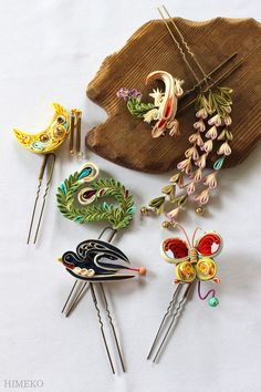 つまみ細工・かんざし Kanzashi | HIMEKO | the top right corner with just falls in three rows with leaves on top