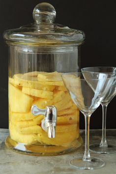 INGREDIENTS: 1 fresh pineapple 1 liter Stolichnaya Vodka DIRECTIONS: Slice the pineapple into chunks and place into a large container, preferably one with a spigot, such as a drink dispenser. Pour the Stolichnaya Vodka directly over th. Cocktails, Party Drinks, Cocktail Drinks, Fun Drinks, Cocktail Recipes, Beverages, Martinis, Vodka Drinks, Vodka Martini