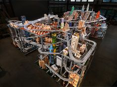 Burden's kinetic sculpture Metropolis II is a mesmerizing cityscape where 1,100 toy cars blaze down 18 lanes of freeways in endless loops. The work took Burden, his chief engineer Zak Cook, and ten assistants four years to build in his Topanga Canyon studio.