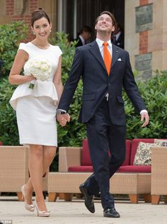 Claire Lademacher opted for a simple peplum dress and Ferragamo heels for her civil ceremony wedding to Luxumbourg's Prince Felix