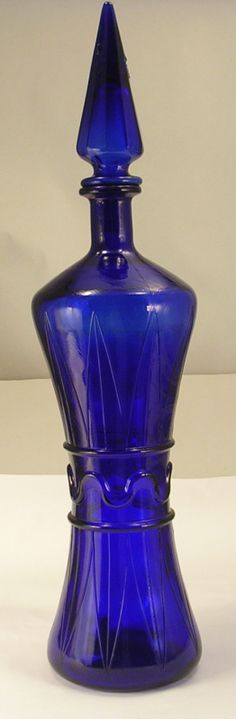 Tall Cobalt Blue Glass Bottle with Stopper Hour Glass Shape. I love this! It has great detail.