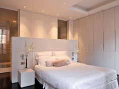 clean simple contemporary bedroom suite with ensuite shower room set behind the bed and banks of fabulous wardrobes to one side. Great lighting too! Hélène et Olivier Lempereur - Architecte décorateur Contemporary Bedroom, Modern Bedroom, Bedroom Decor, Bedroom Divider, Bedroom Ideas, Contemporary Kitchens, Bed In Middle Of Room, White Bedroom, Master Bedroom