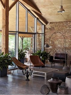 Fantastic mix of modern steel and rustic stone....note the plywood sheet ceiling........k