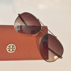 Tory Burch Snakeskin Aviators Beautiful Tory Snakeskin Aviators.  Used but in great condition.   Actual photos coming soon.  Will consider reasonable offers!   Brown gradient lenses abroad snake skin. Comes with cleaning cloth and case.  Please note: 20% off 2 or more items bundled from my closet! Tory Burch Accessories